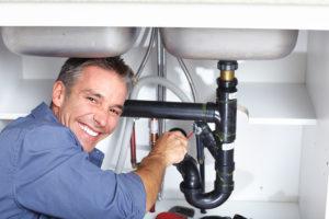 plumbing contractor handling an emergency leak in Woodland Hills, CA