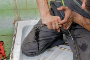 plumber fixing a backed up toilet in Los Angeles, CA