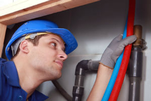 plumber performing a complete repipe service in Chino, CA